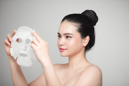 Spa, healthcare. Asian girl with a cosmetic mask. Banco de Imagens