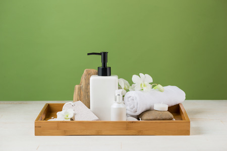 SPA Decoration. Spa composition with cosmetic bottle over green. Stok Fotoğraf