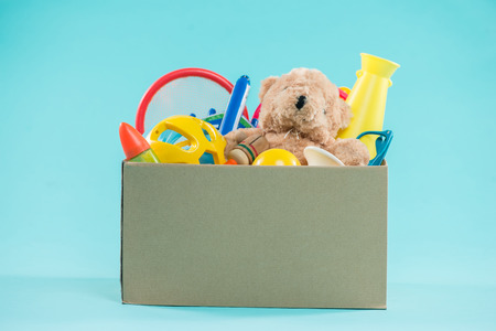 Toy. Donation box with  unwanted items for poor Foto de archivo
