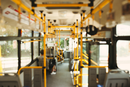Public transportation. Blur image of interior of modern city bus Banco de Imagens - 83319489