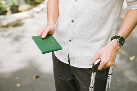 Man hands holding Vietnamese Passport. Ready for traveling.