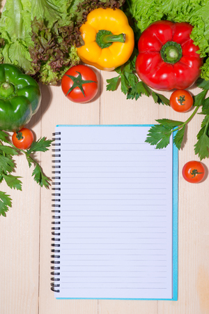 Notebook for culinary recipes with fresh organic vegetables