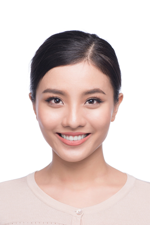 Passport photo of asian female, natural look healthy skin