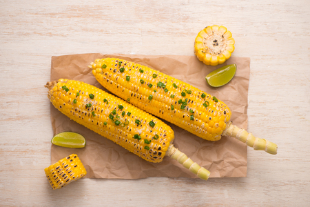 table top: Tasty sweet grilled corn with onion sauce Stock Photo