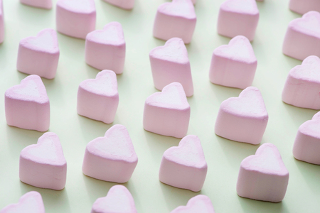 Valentines Day candy hearts marshmallows over green background Stok Fotoğraf - 84003711