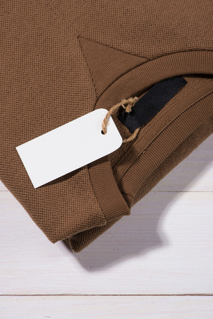Shirt price tag. Rectangular tag is attached to a sweater Stock fotó
