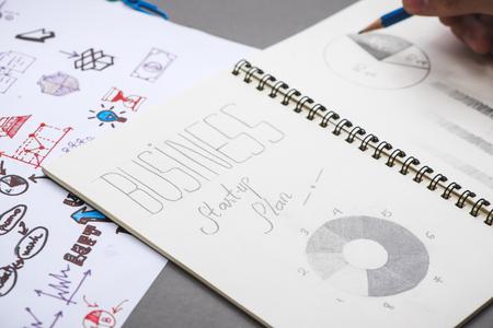 Business concept. Businessman writing idea sketch Banco de Imagens