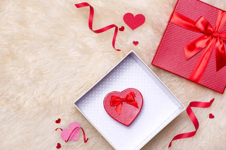 Love Concept. Top view of red gift boxes with bow.