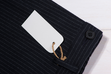Blank paper label with string on pants