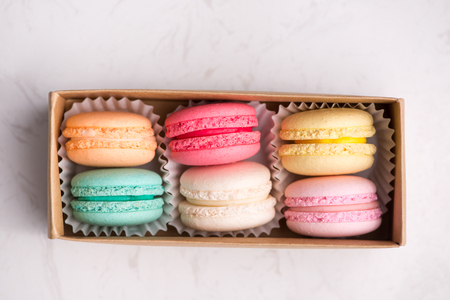 Sweet macarons. Different french cookies macaroons in a paper box. 写真素材