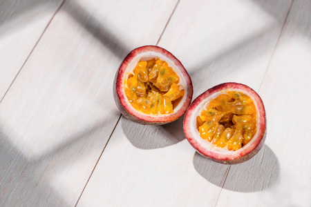 Half of passion fruit on wooden table.