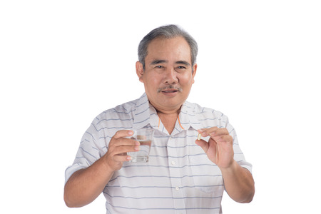 Asian senior man holding omega-3 capsule isolated on white