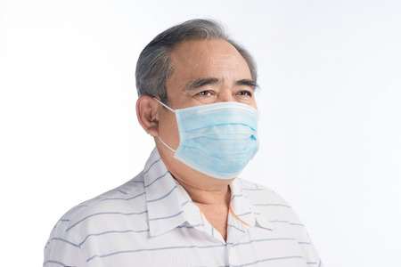 Asian senior man with face mask isolated on white