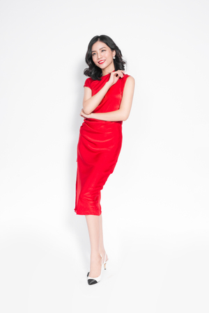Glamour asian woman in stylish red party dress Stock Photo