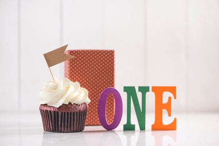 One year Birthday. Delicious creative cupcake and decorative items on table.