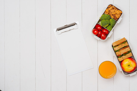 Diet breakfast on desk with blank paper and pen on table Stock Photo