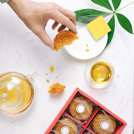 Mid-autumn festival mooncake minimalist style tea party table. Flat lay. Zdjęcie Seryjne