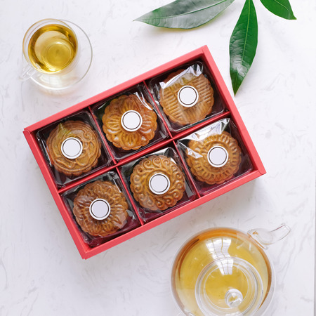 Mid-autumn festival mooncake minimalist style tea party table. Flat lay. 免版税图像