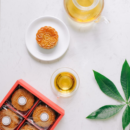 Mid-autumn festival mooncake minimalist style tea party table. Flat lay. Stock Photo