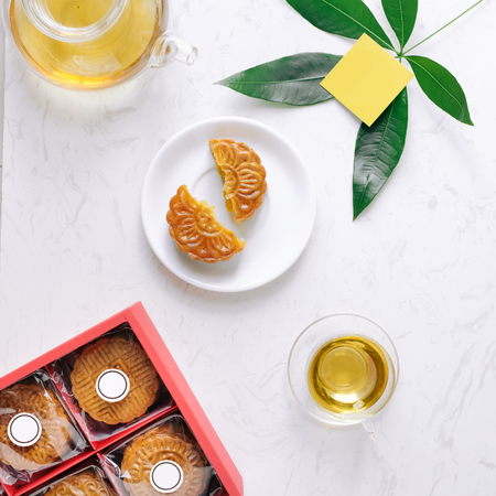 Mid-autumn festival mooncake minimalist style tea party table. Flat lay. Banco de Imagens