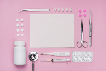 Medical equipment.  Medical concept on pink rose background