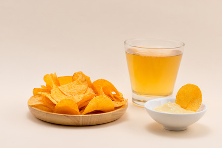 Cheese and onion potato chips with soft drink on table.