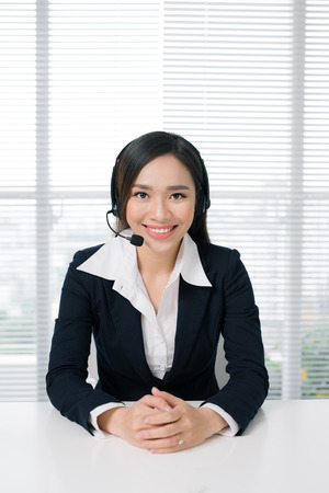 Call center operators. Young beautiful business woman in headset Stock Photo