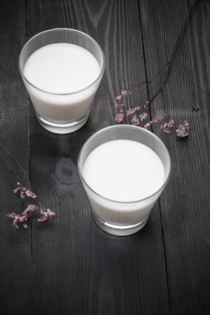 glass of milk on black background Stock fotó