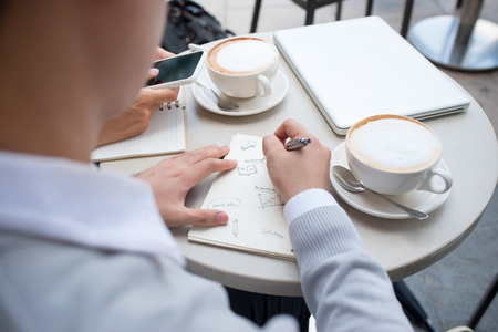 Two male entrepreneur working together and drinking coffee