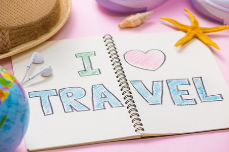 I love Travel written on pen notebook. Vacation Holiday Concept