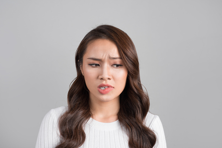 A portrait of young asian woman with annoyed face Zdjęcie Seryjne