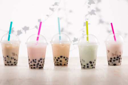 Fefreshing iced milky bubble tea with tapioca pearls in plastic cup Stock Photo