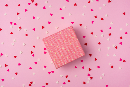 Delicate pink party background with streamers for celebrating with scattered confetti Stock Photo
