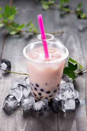 Red bubble tea and black tapioca pearls on crushed ice Stock Photo