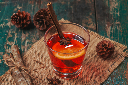 Christmas mulled wine on a rustic wooden table. Stock Photo