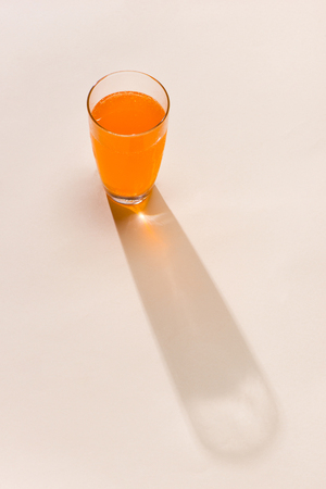 Soft drink.Sparkling orange color drinks with water soda and ice in glass 版權商用圖片