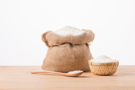 Jasmine white rice in sack isolated on white background