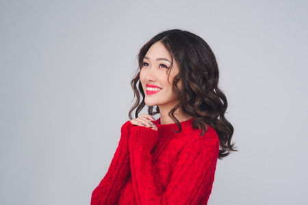 Charming asian young woman in winter clothing