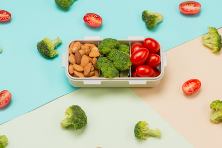 Healthy lunch box with sandwich and fresh vegetables, bottle of water. Healthy eating concept. Top view Imagens