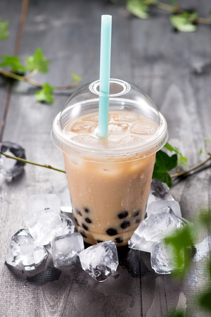Light brown creamy bubble tea and black tapioca pearls on crushed ice Stock Photo