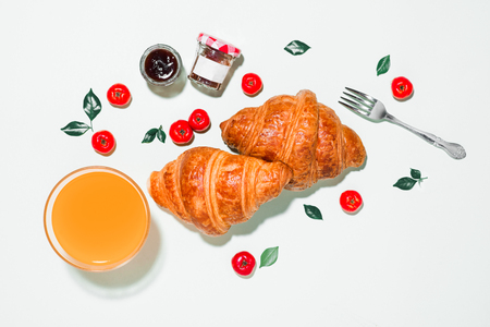 Breakfast with fresh croissants and orange juice, top view Reklamní fotografie