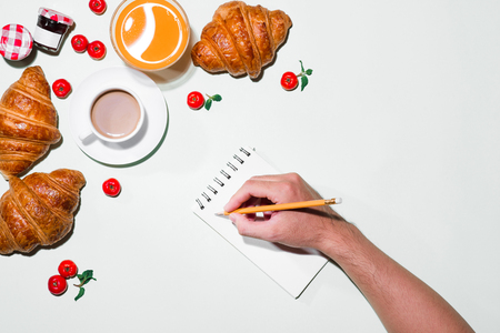Breakfast with fresh croissants and orange juice, top view Stock Photo