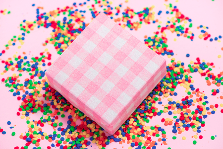 Happy birthday and gift box on candies background Stock Photo
