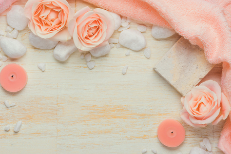 Spa settings with roses. Various items used in spa treatments on white wooden background. Reklamní fotografie
