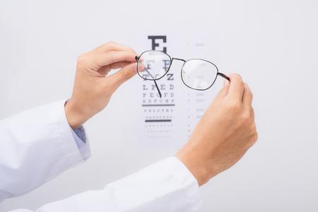 New glasses. Optometrist giving eyeglasses to try