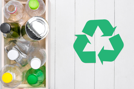 Eco concept. Waste recycling symbol with garbage on stone Stock Photo