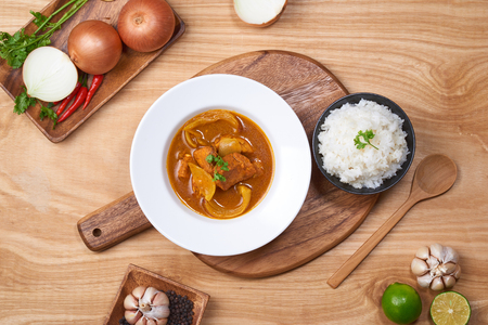 spicy chicken and rice on wooden background Stock Photo