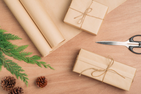 Hand crafted Christmas present gifts box and tools on wooden background