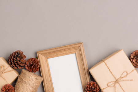 Christmas or New year gift boxes collection wrapped in kraft paper and blank photo frame for text. Stock Photo