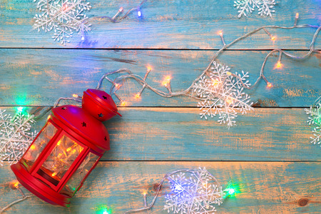 Christmas background with decorations on wooden background. Top view with copy space